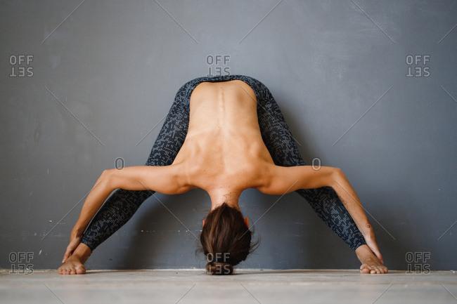 Topless woman doing yoga poses