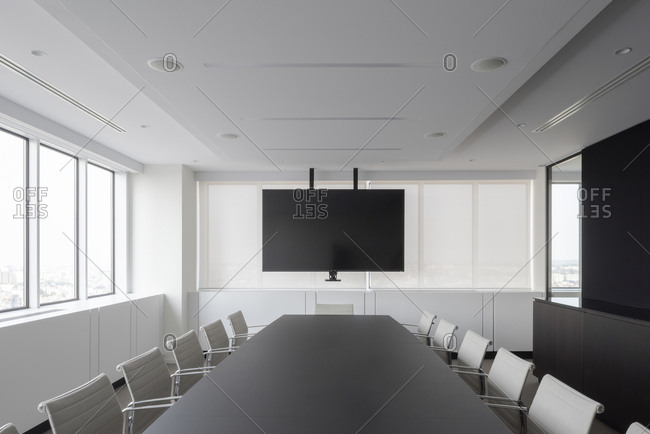 Interior of a modern conference room with large screen