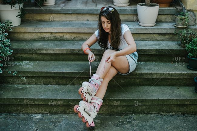 Young woman getting ready for a ride with her roller skates