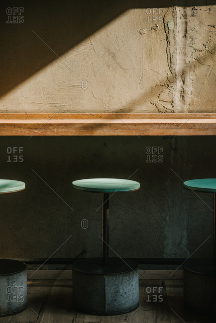 View of a table and bar chairs in empty fast food restaurant
