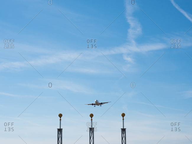 Airplane flying towards approach lighting system at airport