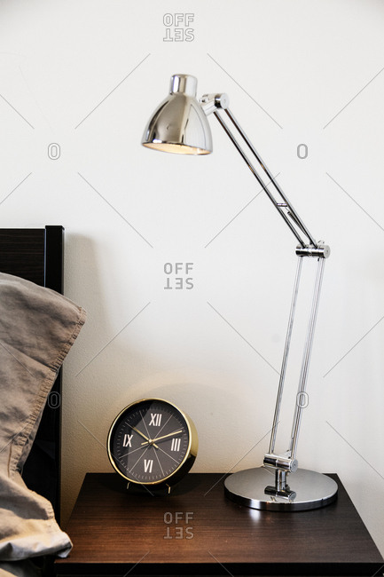 Nightstand with clock and lamp