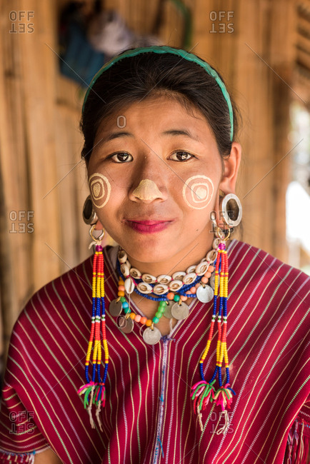 Chiang Mai, Thailand - June 7 2018: Smiling adult woman with traditional bijouterie looking at camera