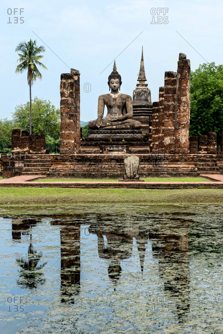Reflection of an ancient Buddhist temple in Sukhothai, Thailand