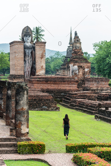 Sukhothai, Thailand - June 18, 2018: Beautiful female in an ancient temple in Sukhothai, Thailand
