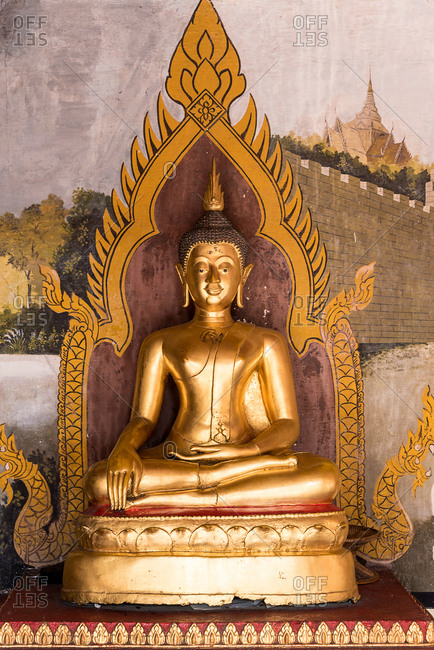 Chiang Mai, Thailand - June 7 2018: Beautiful ancient gold statue of lying Buddha shining in bright sunlight, Thailand