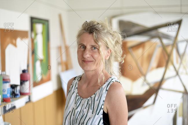 Female painter in her atelier- portrait