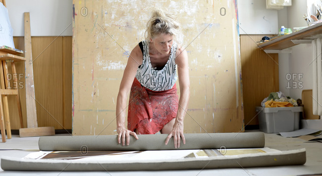 Female painter in her atelier- roll up painting