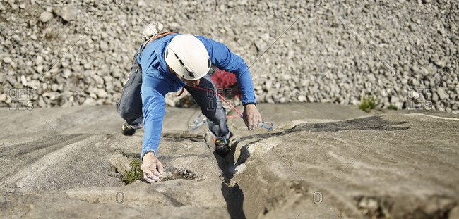 Austria- Innsbruck- Martinswand- man climbing in rock wall