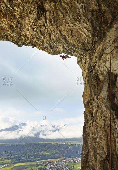 Austria- Innsbruck- Martinswand- man climbing in grotto