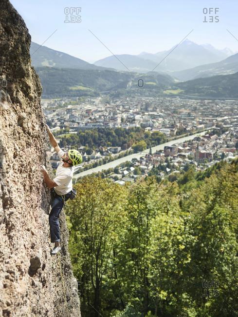 Austria- Innsbruck- Hoettingen quarry- man climbing in rock wall