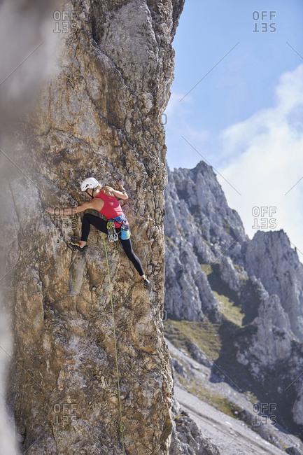 Austria- Innsbruck- Nordkette- woman climbing in rock wall