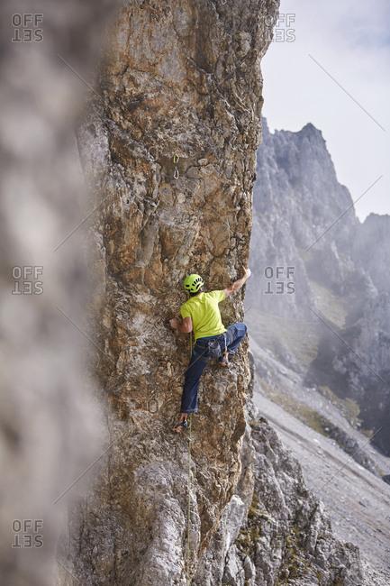 Austria- Innsbruck- Nordkette- man climbing in rock wall