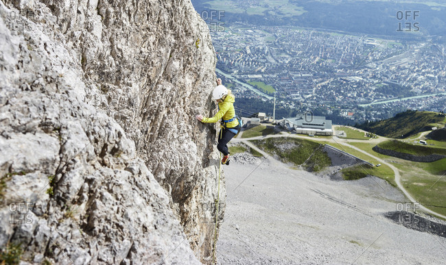 Austria- Innsbruck- Nordkette- woman climbing in rock wall