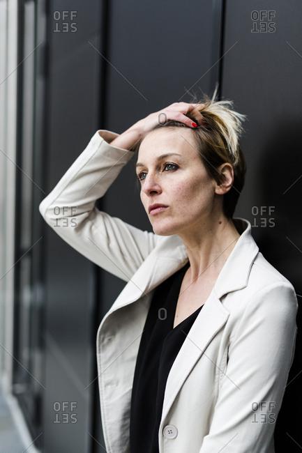 Portrait of pensive businesswoman