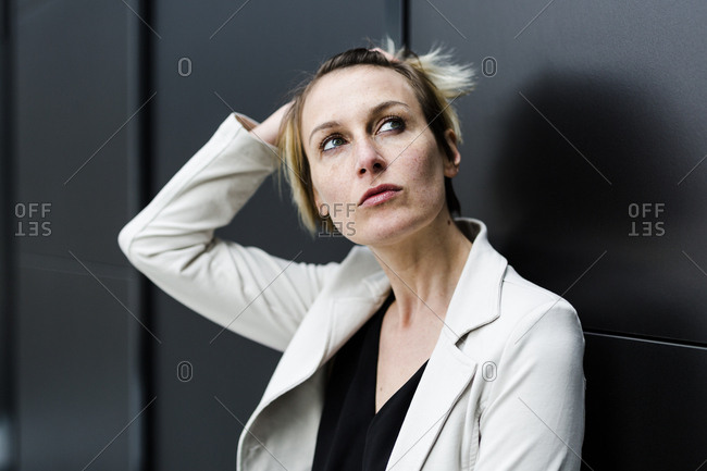 Portrait of pensive businesswoman looking up