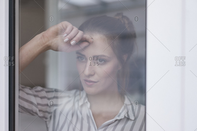 Lonely woman looking out of window