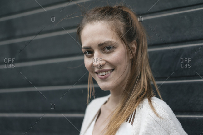 Portrait of a pretty woman in front of roller shutter