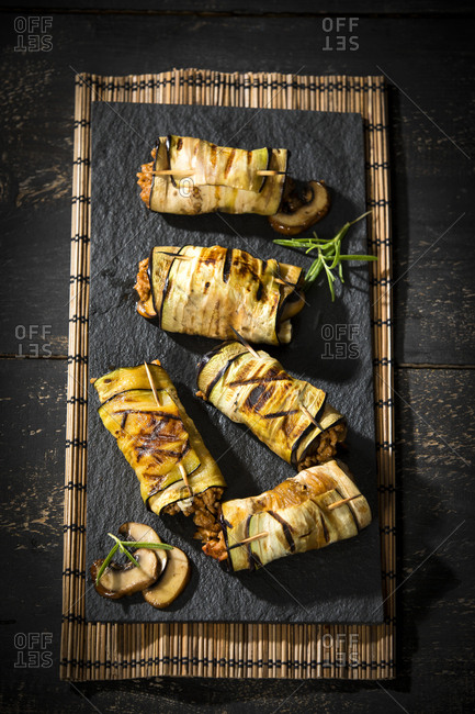 Grilled aubergine slices stuffed with mince meat- champignons and goat cheese
