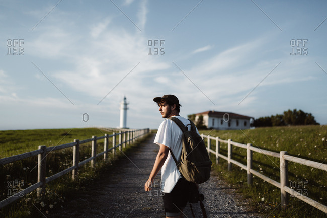 Man on footpath near lighthouse