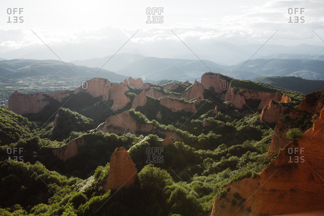 Painterly valley�with green forest between red scales in Cantabria, Spain