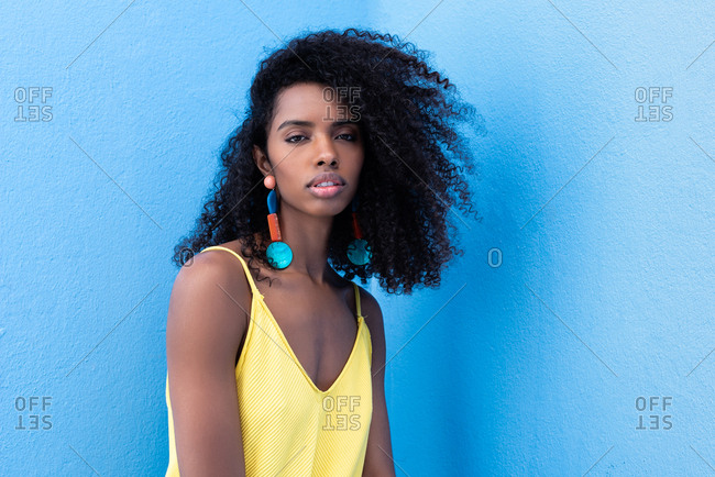 Beautiful black woman in a blue background