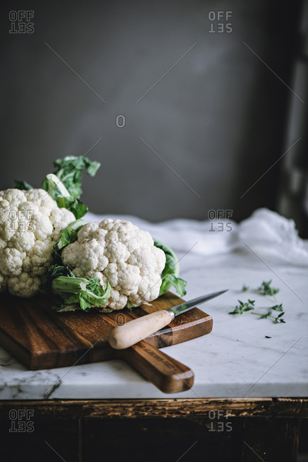 Cauliflower with kitchenware