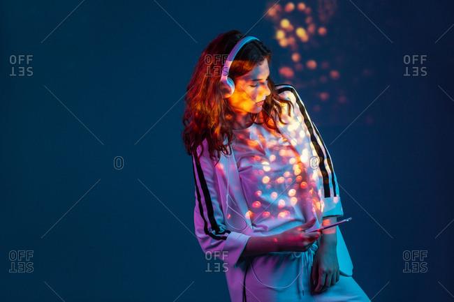 Woman enjoying music with smartphone