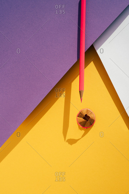 Back to school, modern geomeric background, pink Pencil and shavings from sharpening.