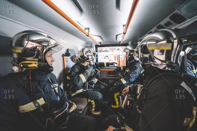 Firemen working inside an emergency vehicle.
