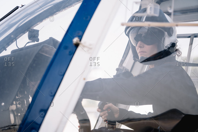 Pilot woman inside a helicopter
