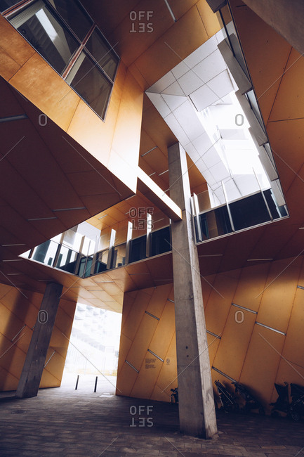 September 11, 2018: From below shot of contemporary interior of passage with orange panels and concrete columns, Denmark