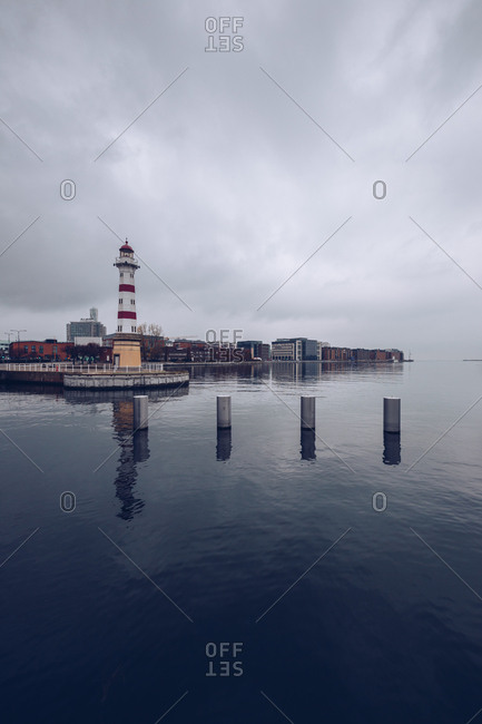 Tranquil city channel with boats in cloudy day