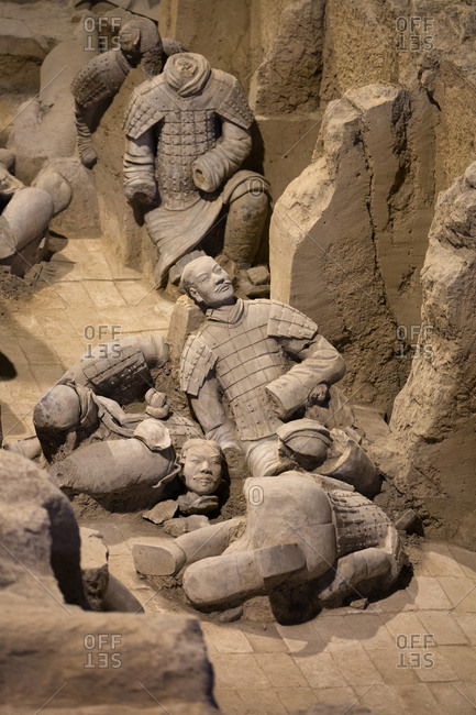 Xi'an, China - March 26, 2016: Pile of broken sculptures of terracotta warriors