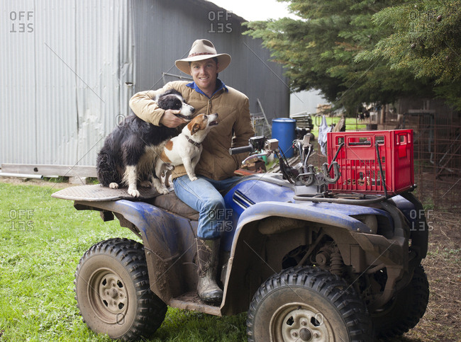 Geelong, Australia - September 30, 2017: Sheep rancher and his dogs