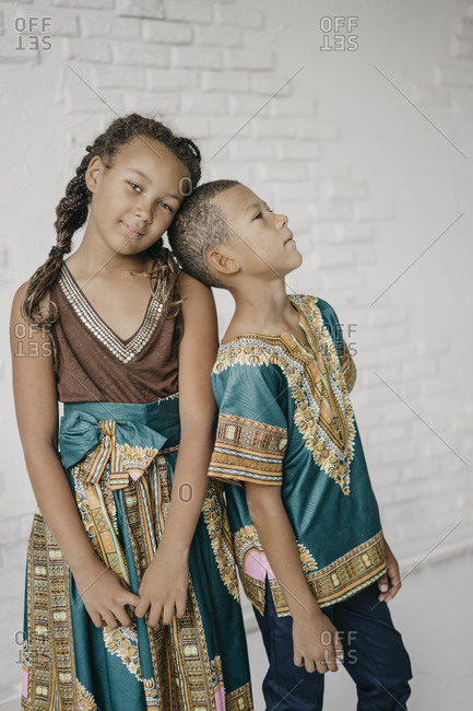 Portrait of a girl and a boy in african clothes