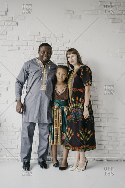 Father, mother and daughter in african clothes. a man and a woman and a child.
