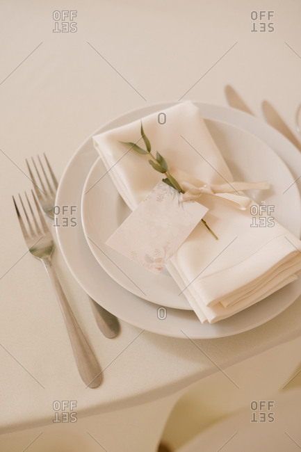 A plate and glasses are already served table, wedding decor in pink.