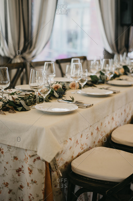 A server table, wedding decor in italian style. the general concept of rustic and boho chic wedding decor in italian style. the general concept of rustic and boho chic