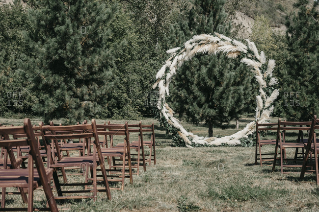 Round wedding arch from pampas grass, wedding decor in italian style. the general concept of rustic and boho chic