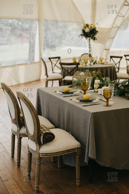 Italian wedding decor. rustic style with lemons. served table with plates and boho chic glasses