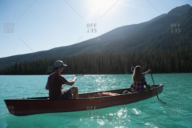 Couple boating on river at countryside