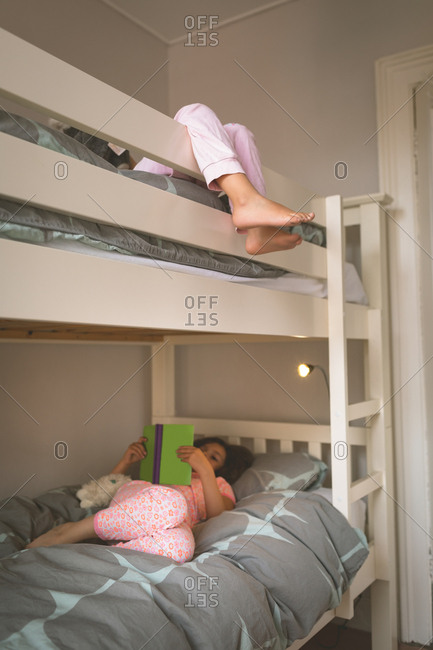 Girls on bed in bedroom at home