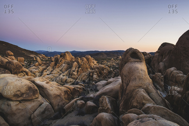 Scenic view of rock formations against sky at Joshua Tree National Park during sunset