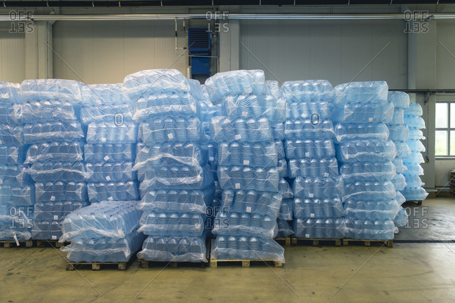 Pallets of water bottles in warehouse