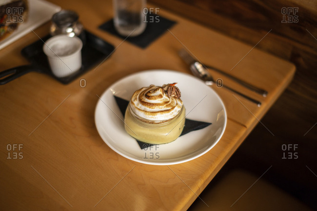 High angle view of dessert served in plate on wooden table