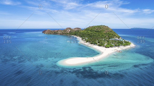 Scenic view of island amidst sea against sky