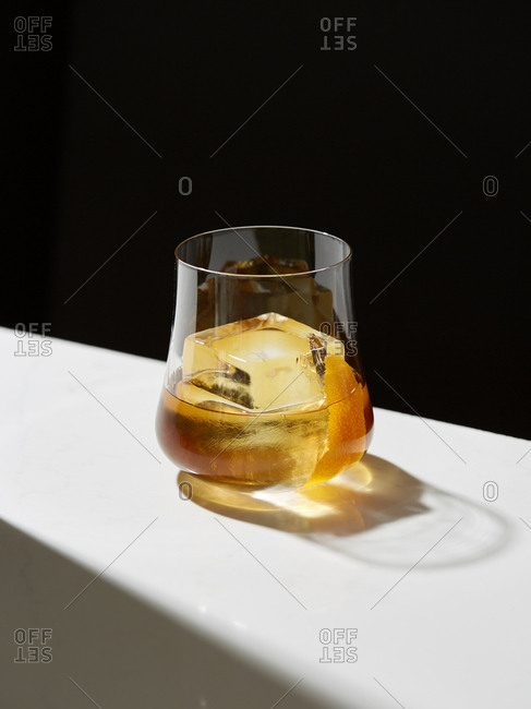 Close-up of drink served on table against black background
