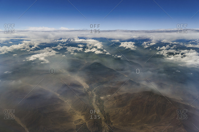 Scenic view of Andes Mountains against blue sky