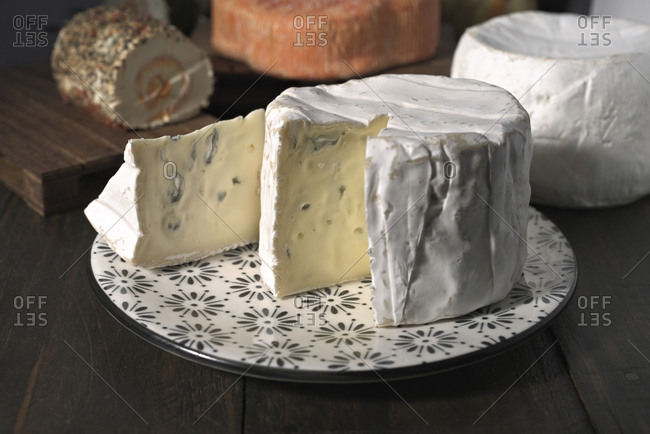 Close-up of white cheese in plate on wooden table